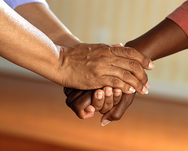 Image of Clasped Hands Signifying Support